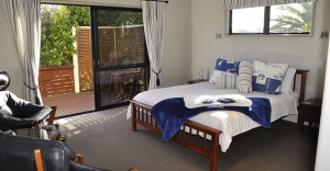 Baylys-beach-accommodation-lighthouse-suite-sunset-view-lodge